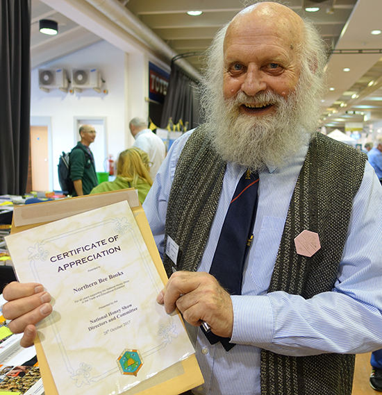 Jerry Burbidge from Northern Bee Books receives a certificate of appreciation for more than 40 years of support for the National Honey Show